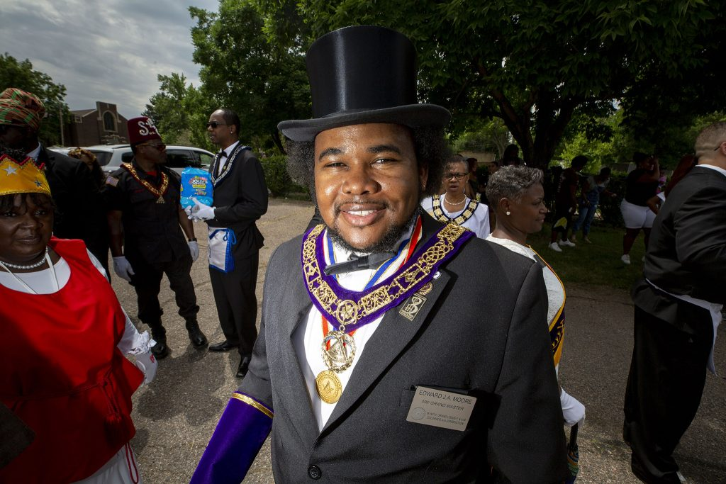 Edward J.A. Moore prepares to march in Denver's Juneteenth Parade. June 19, 2021.