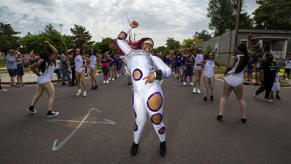Jazoni Johnson leads the Platinum Diva's Denver's Juneteenth Parade. June 19, 2021.