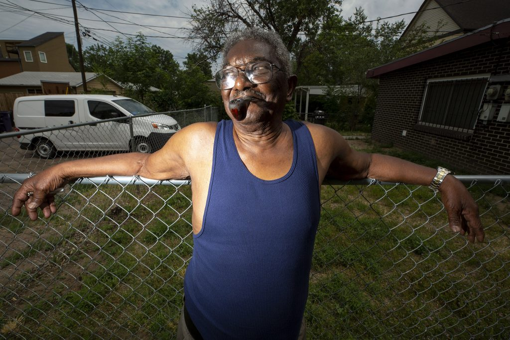 Evernard Jones smokes a pipe as he watches Denver's Juneteenth Parade from 26th Avenue. June 19, 2021.