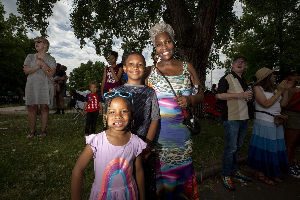 Diana Gadison watches Denver's Juneteenth Parade with her grandkids,  Dustin and Layah. June 19, 2021.