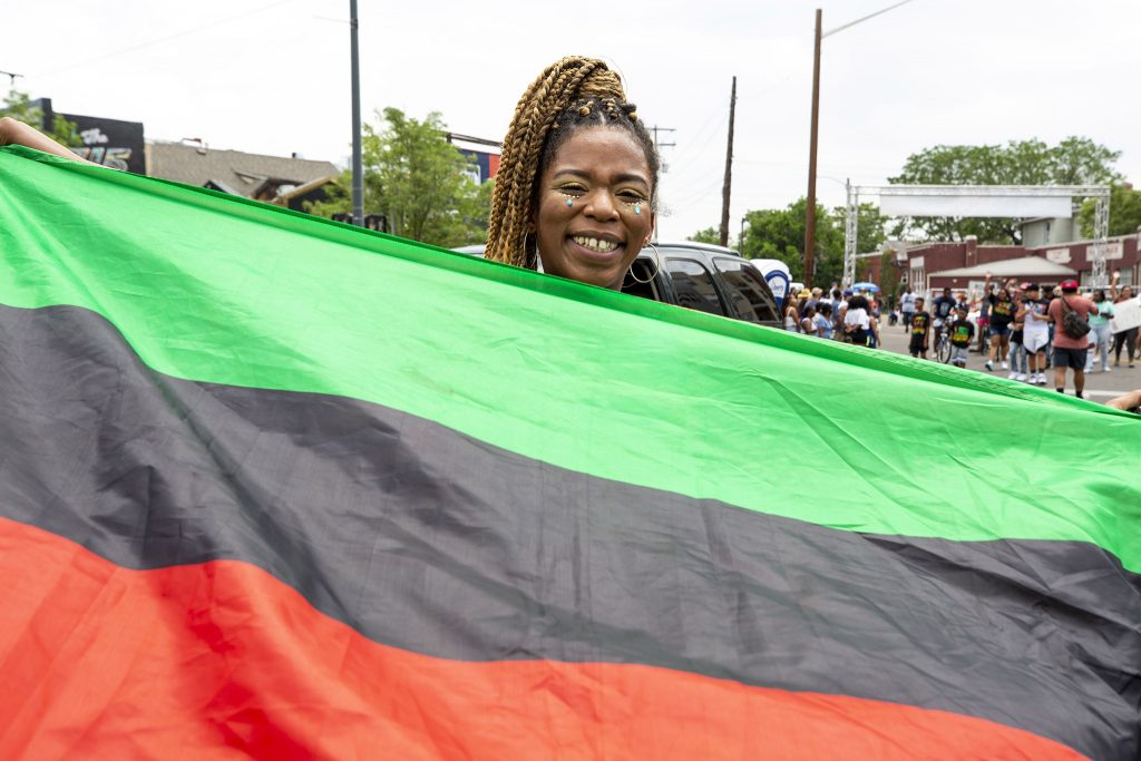 Kahdijah James marches with the Carribbean Student Alliance in Denver's Juneteenth Parade. June 19, 2021.