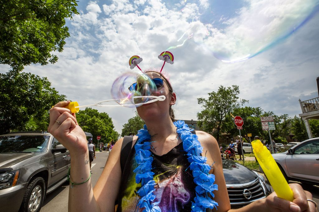 Lisa Gaylord with the Ideas theater group blows bubbles during Denver's Juneteenth Parade. June 19, 2021.