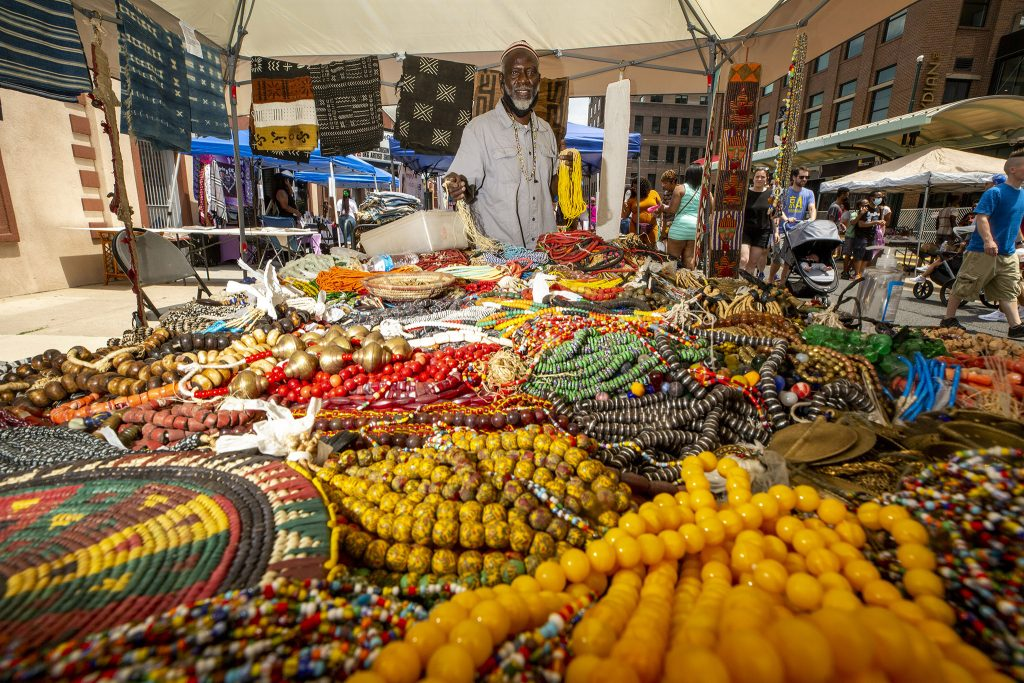 Bakary Dukary has tons of jewlery for sale at the Five Points Music Festival. June 19, 2021.