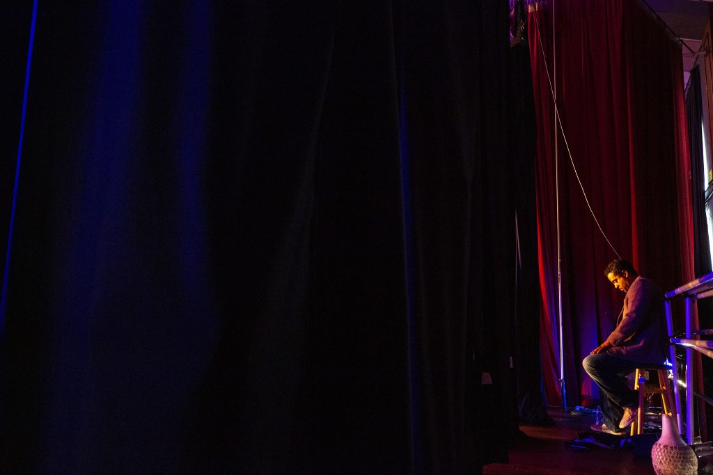 Malik Robinson sits in the wings of Cleo Parker Robinson Dance's theater during a panel discussion on race and the arts on Juneteenth. June 19, 2021.