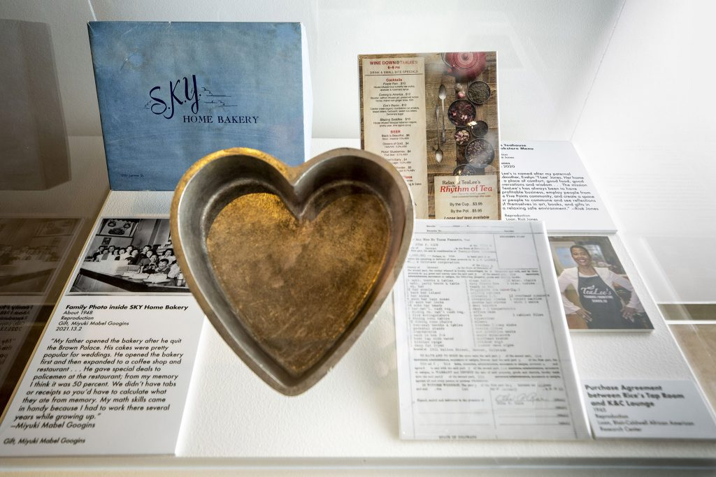 Items from the SKY Home Bakery and TeaLees inside the Five Points Plus: Neighborhood Memory Project exhibit at the History Colorado Center. June 23, 2021.