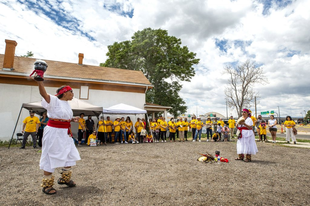 """Kalpulli ColorAtzlan members bless the land during a protest of public-private partnerships on the """"Triangle"""" parcel of the National Western Center development site. June 26, 2021."""
