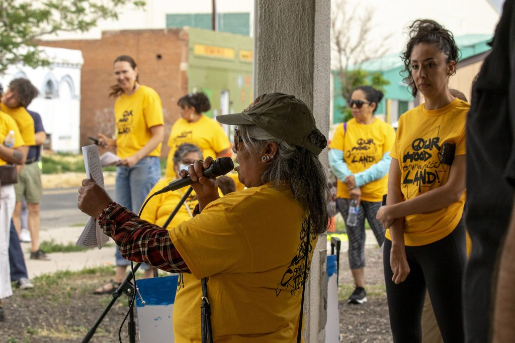Council Member Candi CdeBaca (right) watches as Angelina Torres speaks during a protest public-private partnerships. June 26, 2021.