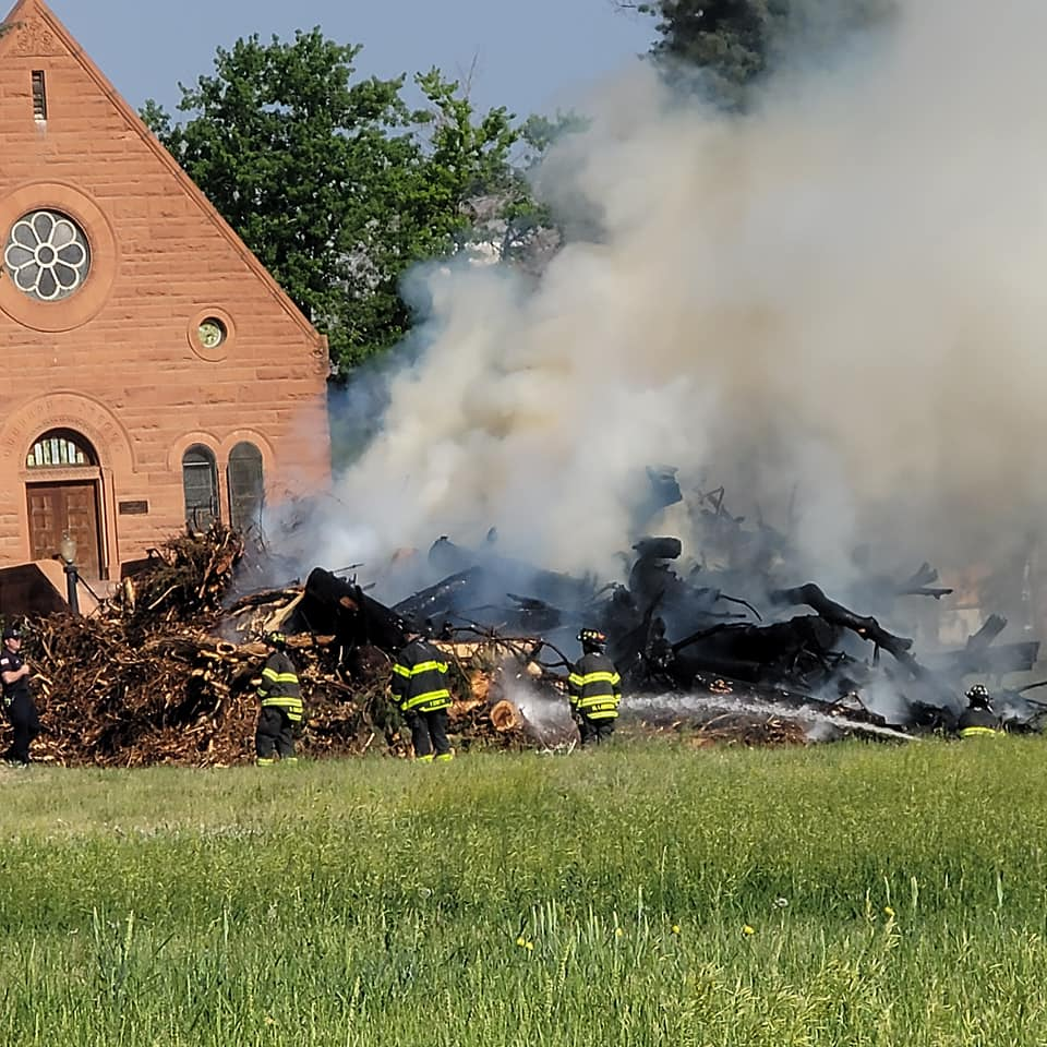 Cut down trees at the Loretto Heights campus in Harvey Park caught fire on June 17, 2021.
