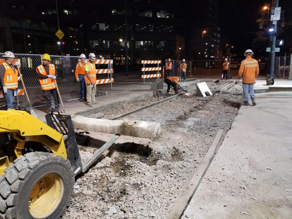 Construction crews pull up a section of light rail track on 18th and California in 2018. (Courtesy of RTD)