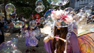 Prumrose the Fairy blows bubbles and the minds of guests walking into the Colorado Renaissance Festival in Larkspur. July 4, 2021.