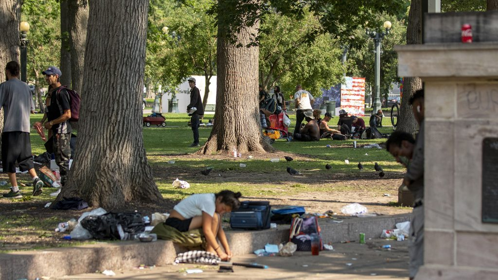 People hang out in Civic Center Park. July 10, 2021.