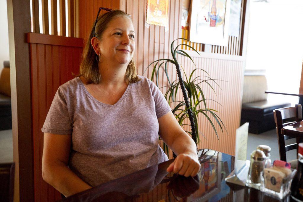 Elizabeth Harms sits at a table at JJ's Bistro. July 12, 2021.