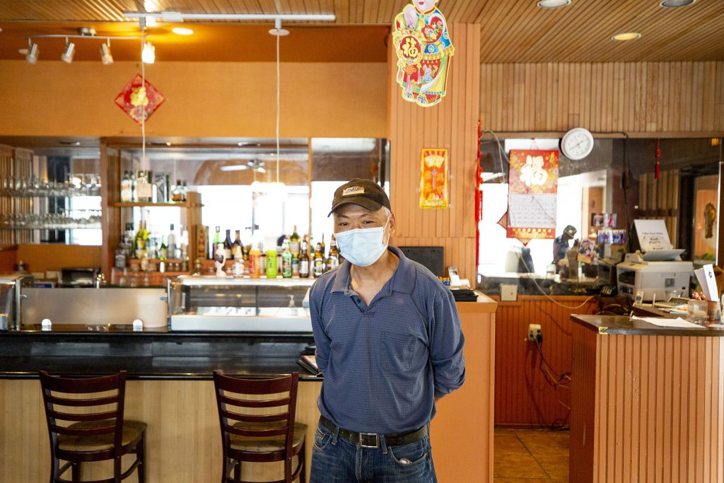Jia Rong Wang, owner of JJ's Bistro, stands in his restaurant on the second floor of Sakura Square. July 12, 2021.