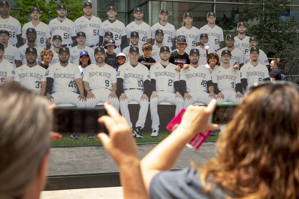 """Kids pose with 2-D Colorado Rockies outside of the """"Play Ball"""" exhibition at the Colorado Convention Center. July 13, 2021."""