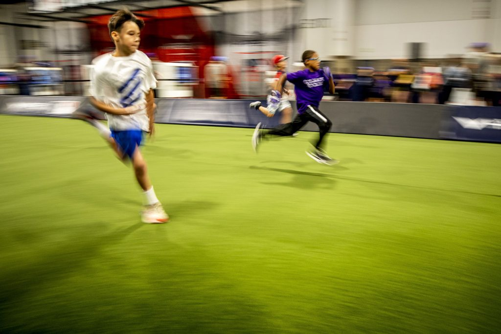 """Kids race inside the """"Play Ball"""" exhibition at the Colorado Convention Center. July 13, 2021."""