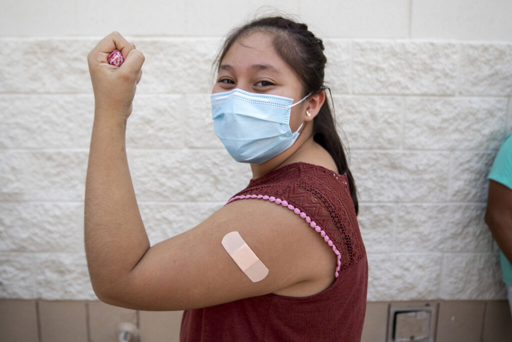 Kehara Chale just got a COVID-19 vaccine at a mobile clinic in Aurora. July 23, 2021.