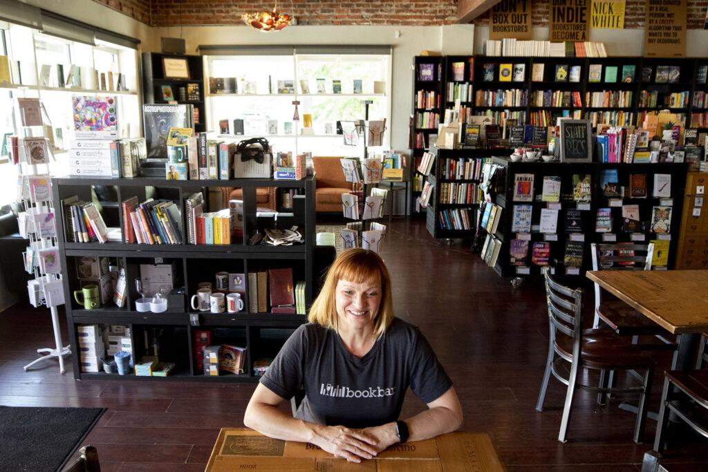 Bookbar owner Nicole Sullivan sits in her Tennyson Street business. July 24, 2021.