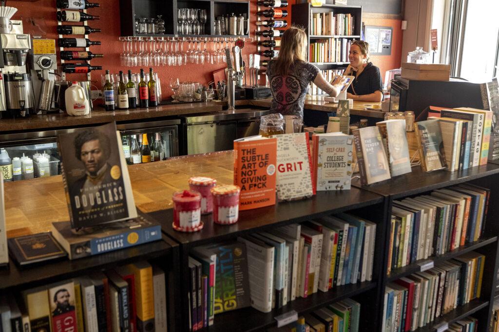 A customer places an order inside Bookbar on Tennyson Street. July 24, 2021.