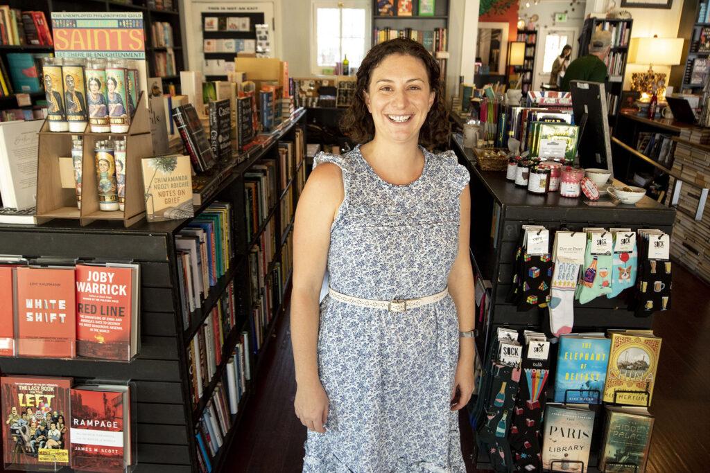 Sarah Frazer stands inside Bookbar on Tennyson Street. July 24, 2021.