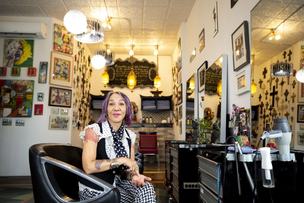 Cue Perez sits inside Babooshka, her hair salon on East Colfax Avenue. July 24, 2021.