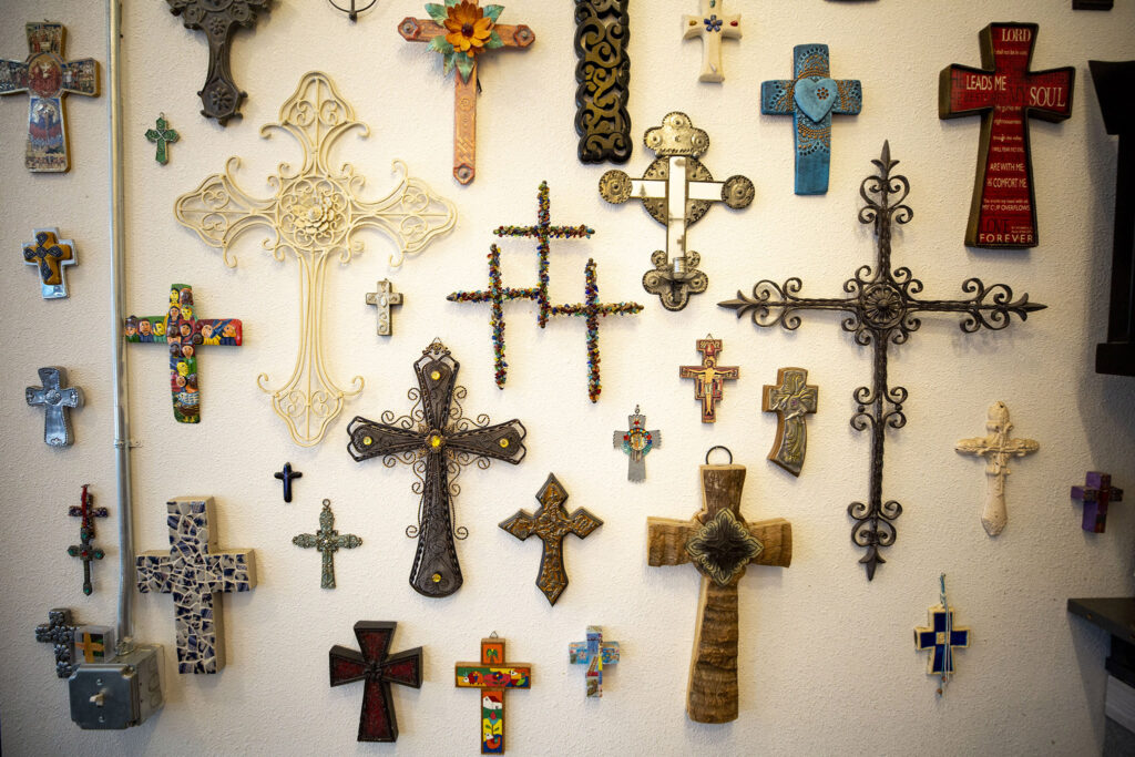 Crosses on the wall at the Babooshka hair salon on East Colfax Avenue, which were all gifts from customers. July 24, 2021.