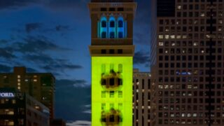 """""""Aborning New Light"""" on the  Daniels and Fisher Tower. The film is a Night Lights Denver projection created by Kei Ito in collaboration with The Center for Fine Art Photography."""
