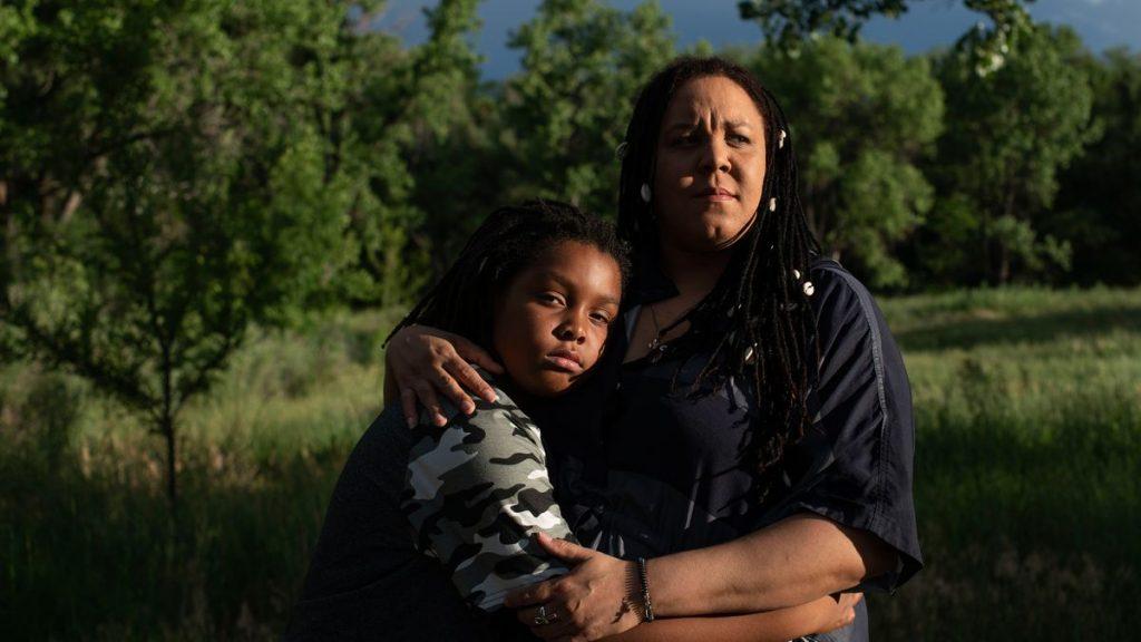 Eleven-year-old Kal-El poses with his mother, Jennifer Uebelher, in a Denver park.