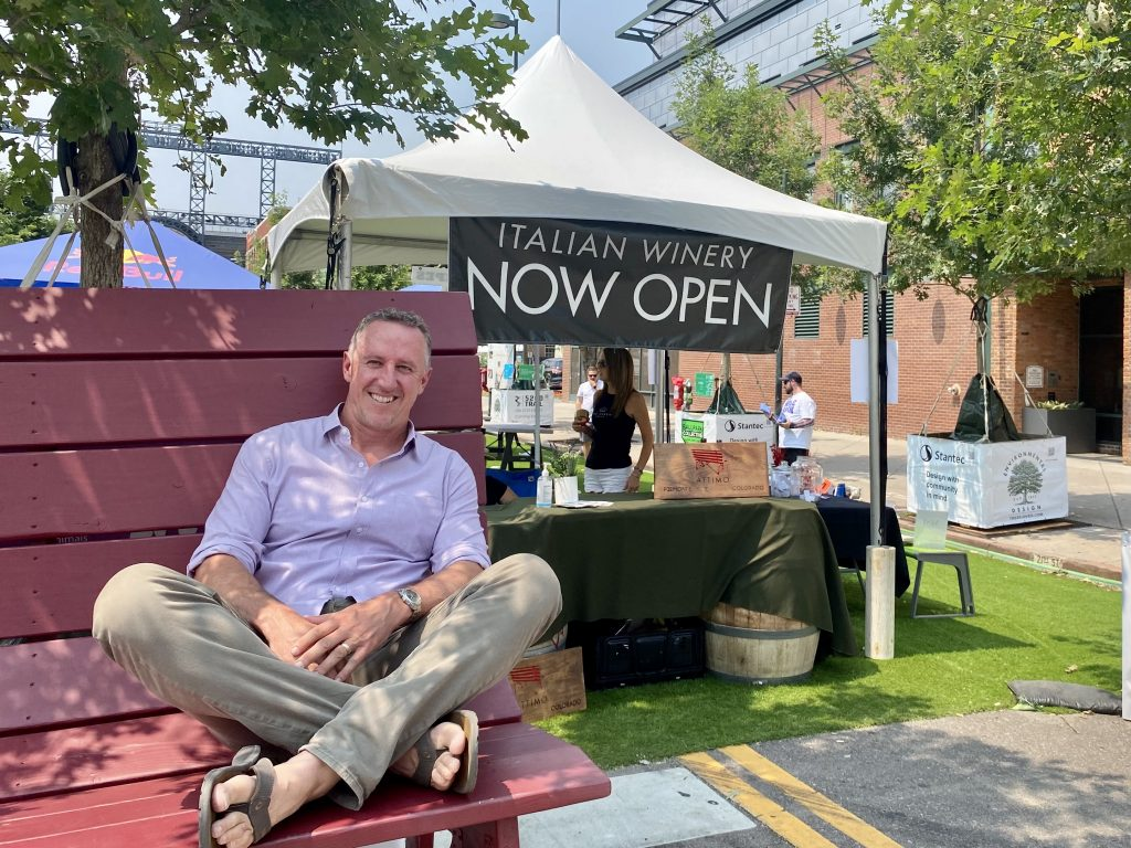 Snooze founder Jon Schlegel in front of a booth for his new venture, Attimo Wine.