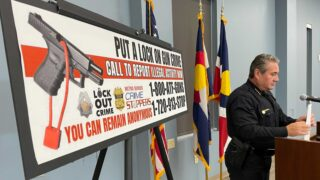 Denver Police Chief Paul Pazen stands next to a billboard encouraging people to report gun crimes following a press conference on Wednesday, July 28, 2021. (Esteban L. Hernandez/Denverite)