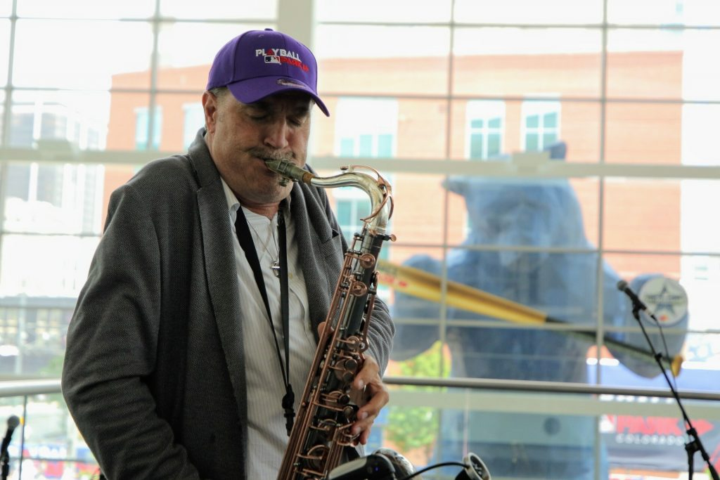 Steve Watts plays the saxophone at the Colorado Convention Center in Denver during the MLB All-Star week on Tuesday, July 13, 2021.