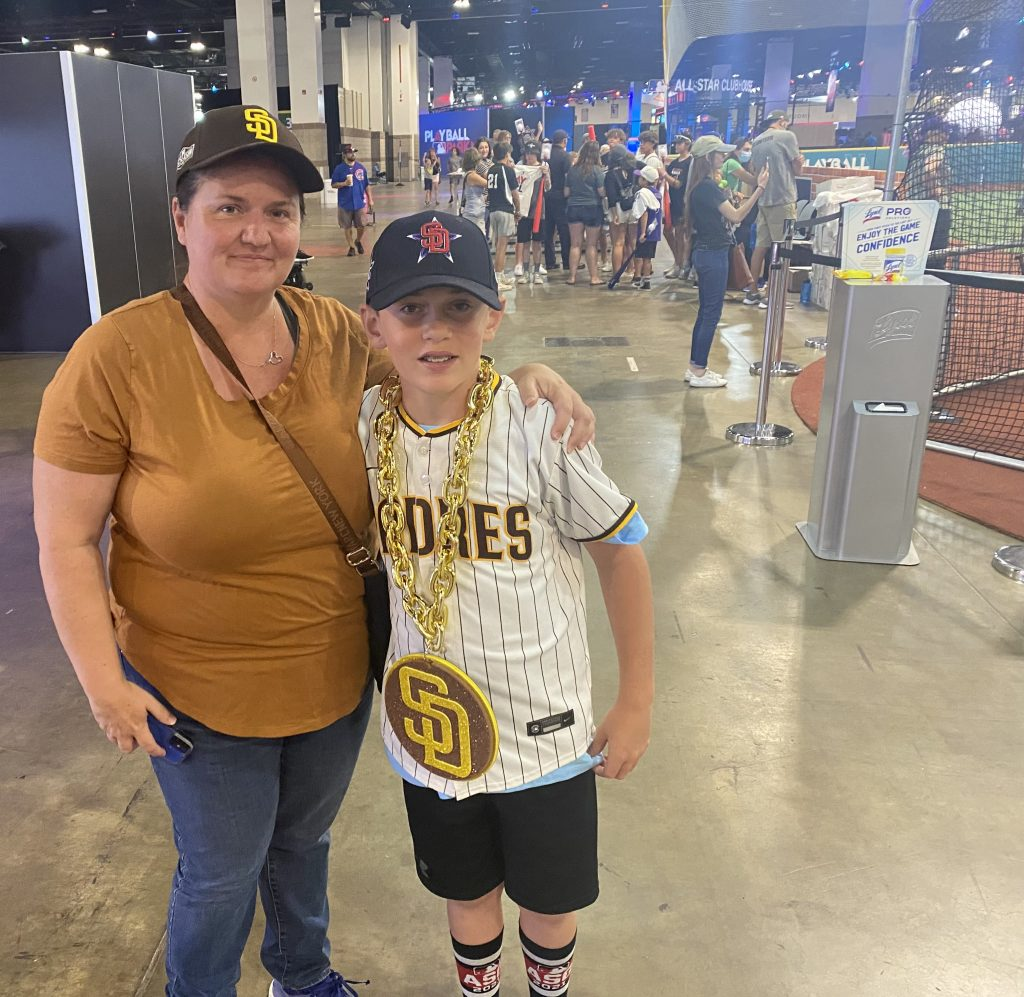 Leslie Lenz and her son, Connor, rock San Diego Padres gear at the Colorado Convention Center in Denver on Tuesday, July 13, 2021.
