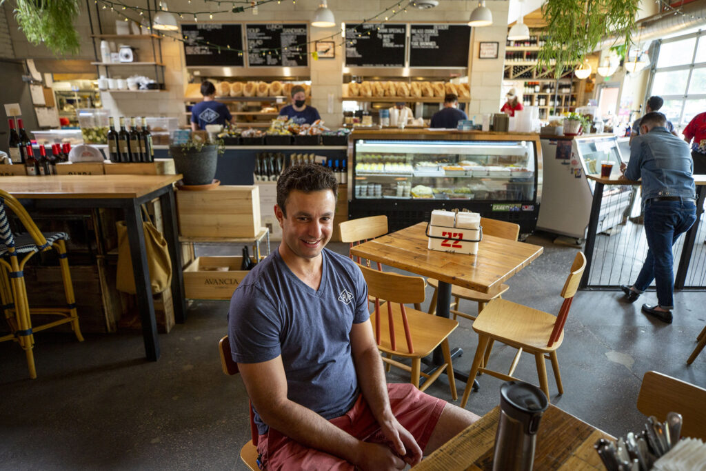 Anthony Lygizos, owner of Levan Deli, sits in his Golden Triangle restaurant. Aug. 5, 2021.