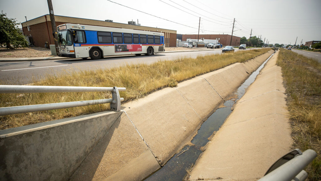 An RTD bus lumbers east down 47th Avenue in Montbello. Aug. 10, 2021.