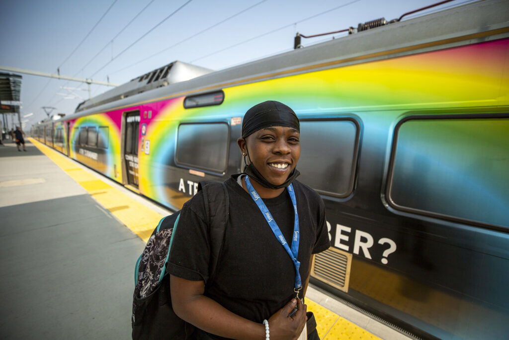 Anterica Roberts waits to board a train bound for DIA at RTD's Peoria Street station in Aurora. Aug. 10, 2021.