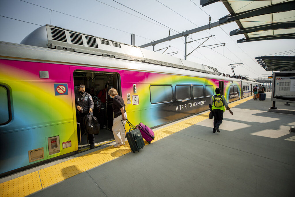 Passengers board an A Line train at RTD's Peoria Street station in Aurora. Aug. 10, 2021.
