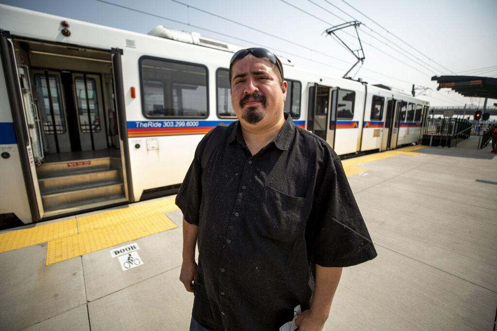 Luis Meza prepares to board an R Line train at RTD's Peoria Street station in Aurora. Aug. 10, 2021.