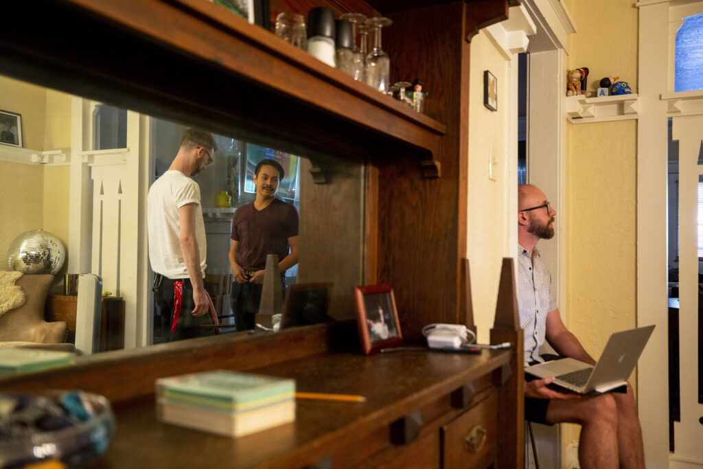 """Lars Preece (left to right), Jerome Síbulo and Nathan Hall work through Act 5 of """"UNBOUND: A New Opera"""" in director Nathan Hall's living room. Aug. 12, 2021."""