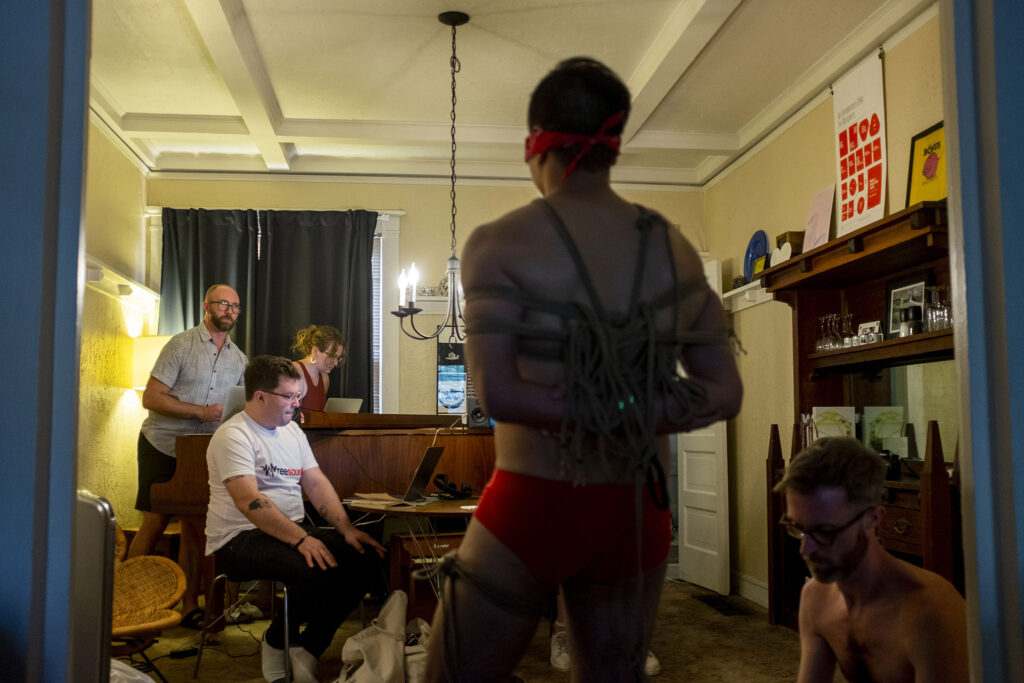 """Nathan Hall (left to right), Isaac Linder, Leah Podzimek, Jerome Síbulo and Lars Preece work through Act 5 of """"UNBOUND: A New Opera"""" in Hall's living room. Aug. 12, 2021."""