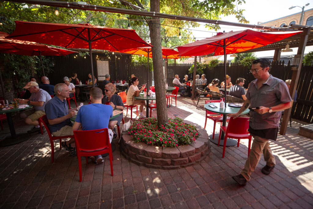 A busy day on the patio at My Brother's Bar. Highland, Aug. 13, 2021.