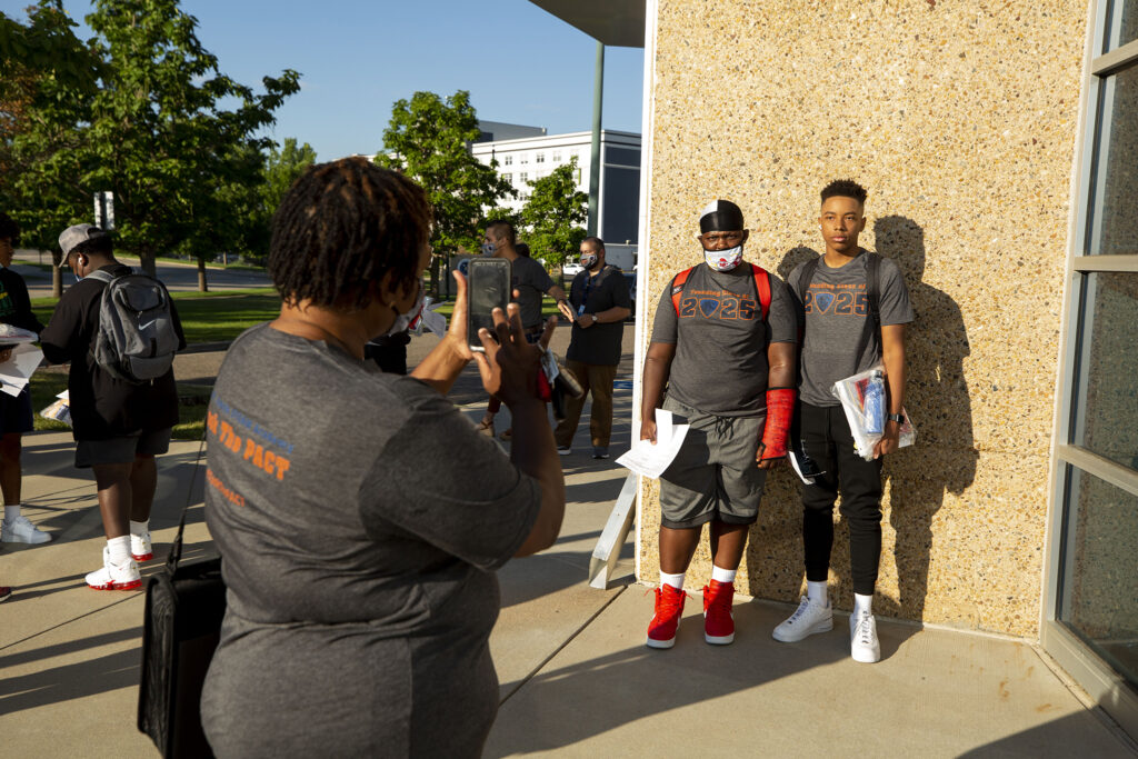 Carmen Matthews makes her son, Jessie, and Xavier Harley pose for a picture on the inaugural first day of school at Robert F. Smith STEAM Academy. Aug. 23, 2021.