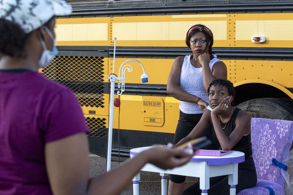 """Faith Angelise Goins-Simmons (left) and Nylah Langford work on the play """"Sojourners Project: Busing"""" during a rehearsal in the parking lot of the Rising Star Missionary Baptist Church in Aurora. Aug. 23, 2021."""