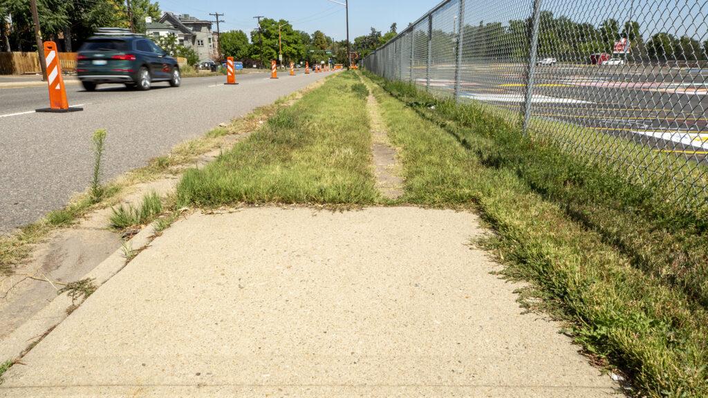 A sidewalk ends on Josephine Street by East High School. Aug. 24, 2021.