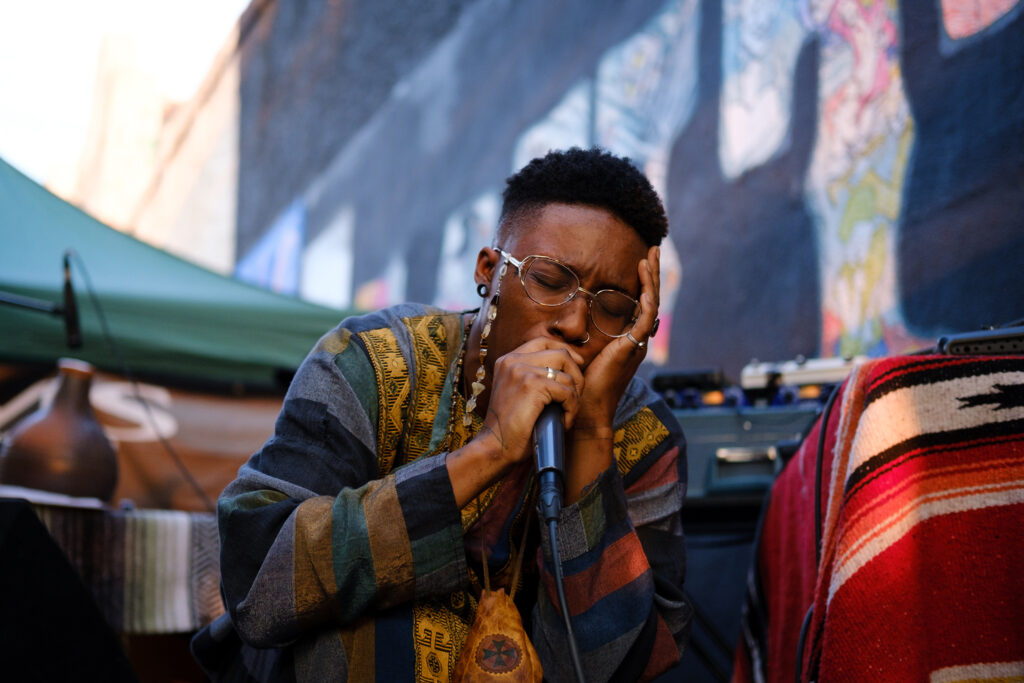 """Korryne """"Koko La"""" Coleman of RAREBYRD$ performs outside of Mutiny Information Cafe on Broadway at the Underground Music Showcase in Denver on Sunday, August 29, 2021."""