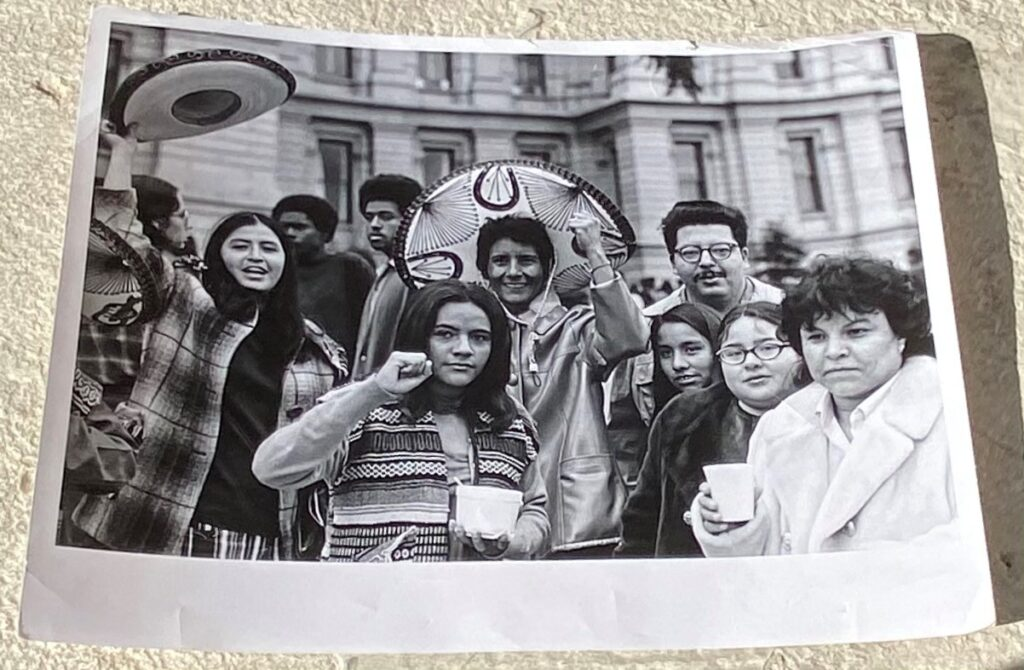 Cathy Prieto (center) holds her fist up during a demonstration at the State Capitol during the late 1960s. (Courtesy of Historic Denver)