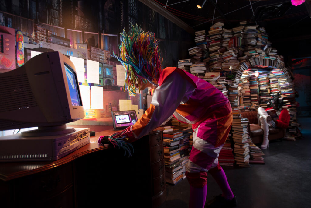Meow Wolf characters exploring the past in the Library, part of Meow Wolf's Denver exhibit.