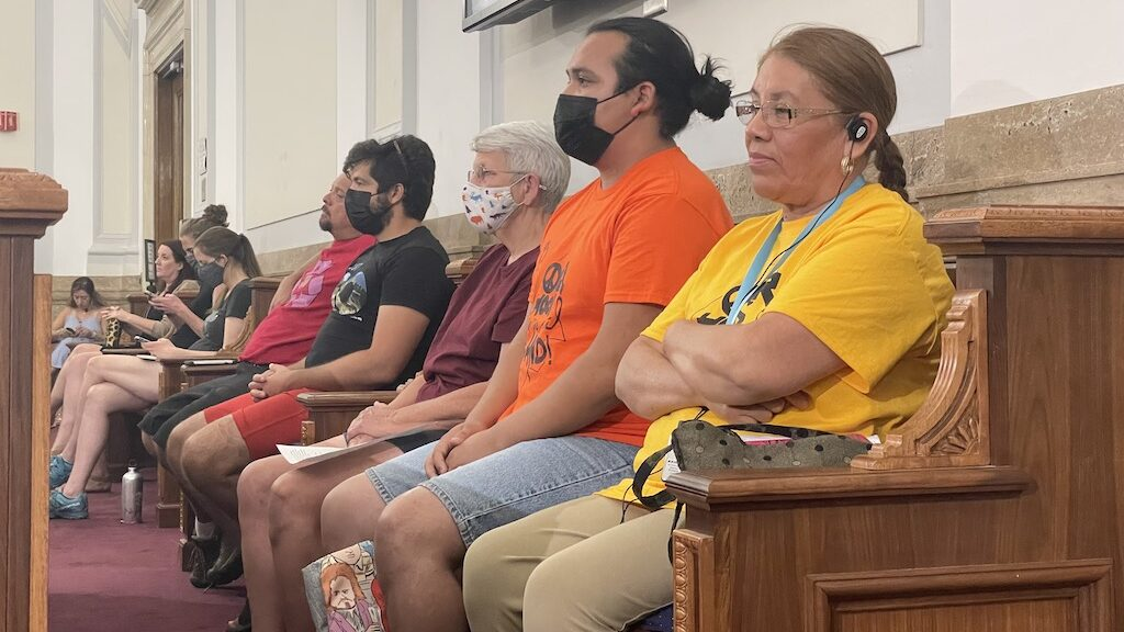 GES Coalition members from left: Carol Briggs (in red), Alfonso Espino and Mercedes Gonzalez during a Denver City Council public hearing on Monday, August 16, 2021. (Esteban L. Hernandez/Denverite)