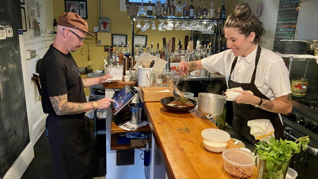 Chefs Royce Oliveira and Chelsea Schumacher work dinner service at To the Wind Bistro on August 4, 2021. Rebecca Spiess/Denverite
