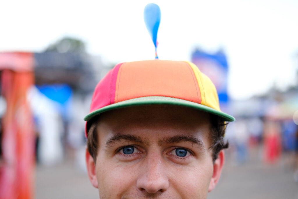 Trace Fetterer sports a pinwheel hat at the Underground Music Showcase main stage in Denver on Sunday, August 29, 2021.