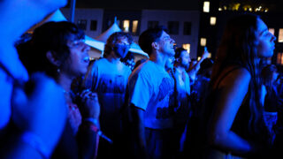 People dance to a song by Shannon and The Clams at the Underground Music Showcase main stage in Denver on Friday, August 27, 2021.