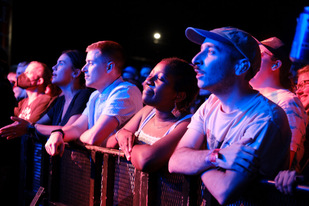 Fati Zulaikha, center, and Ryan Galuchi, right, enjoy a moment during Pinegrove's performance at the Underground Music Showcase main stage in Denver on Friday, August 27, 2021.